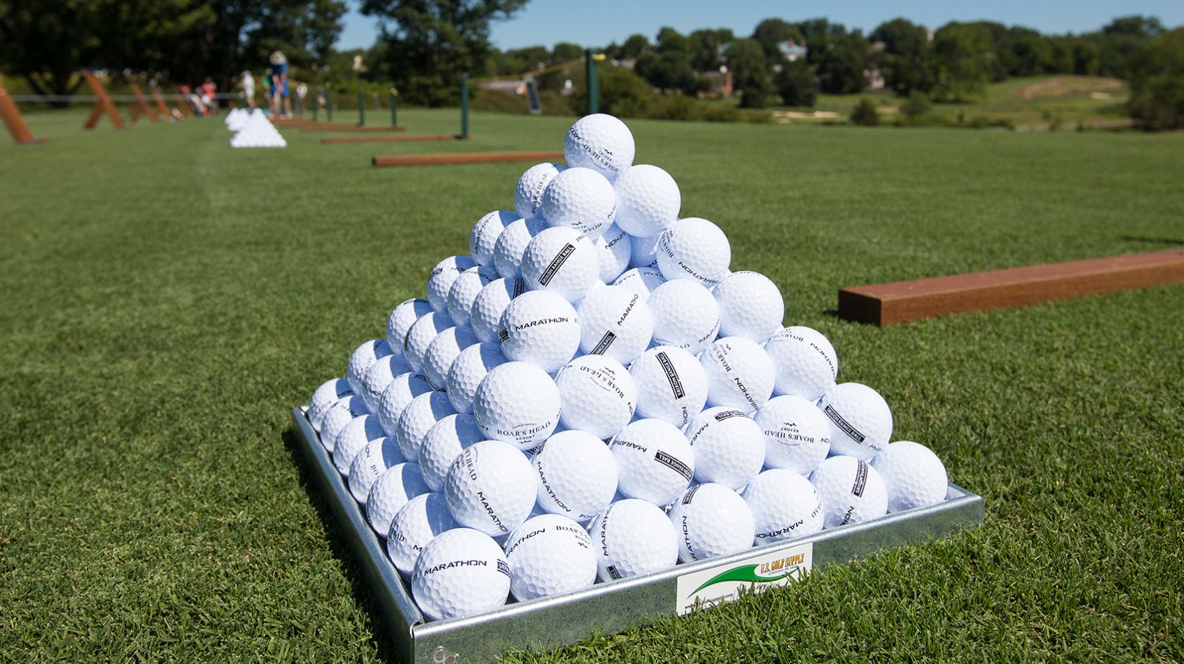golf balls stacked in a pyramid